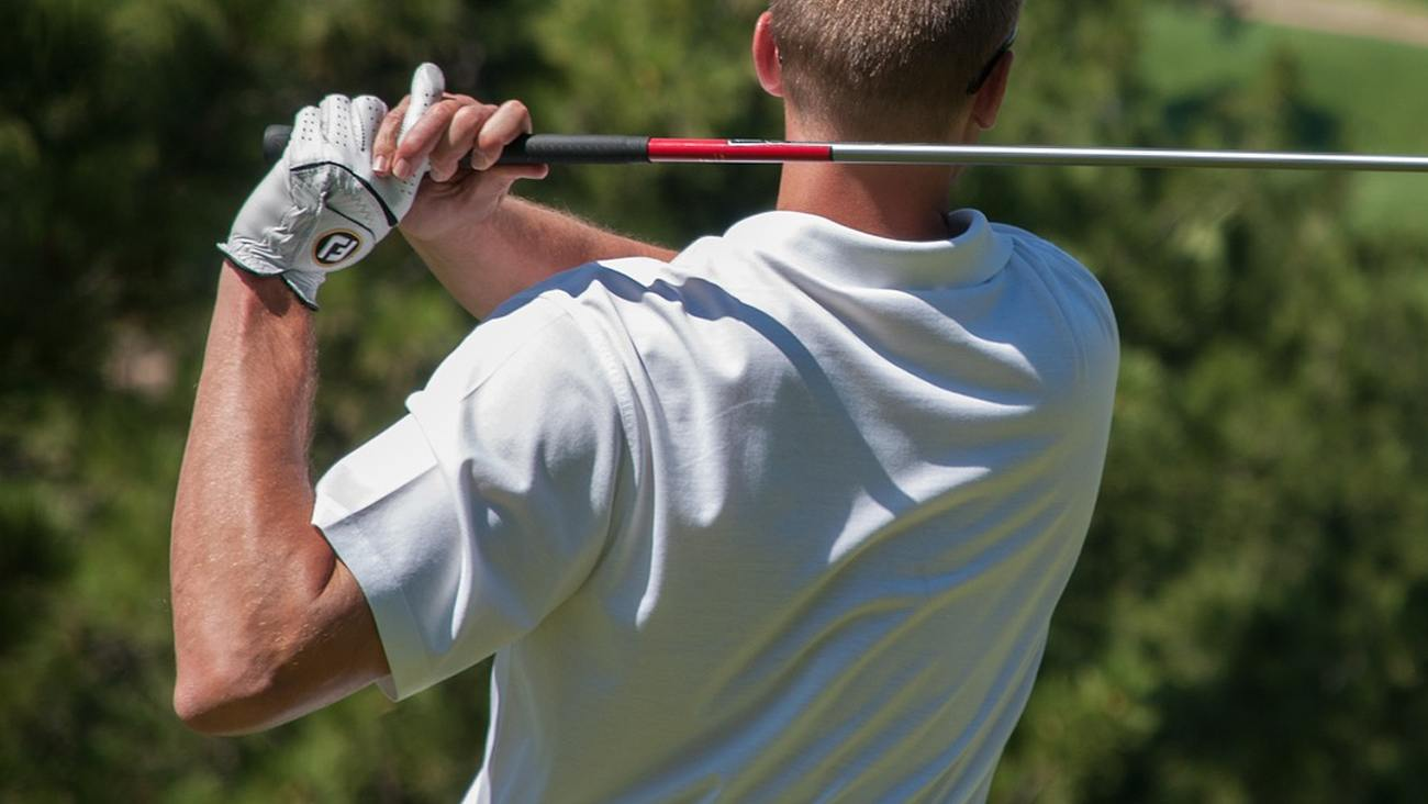 a golf club being used during a swing.