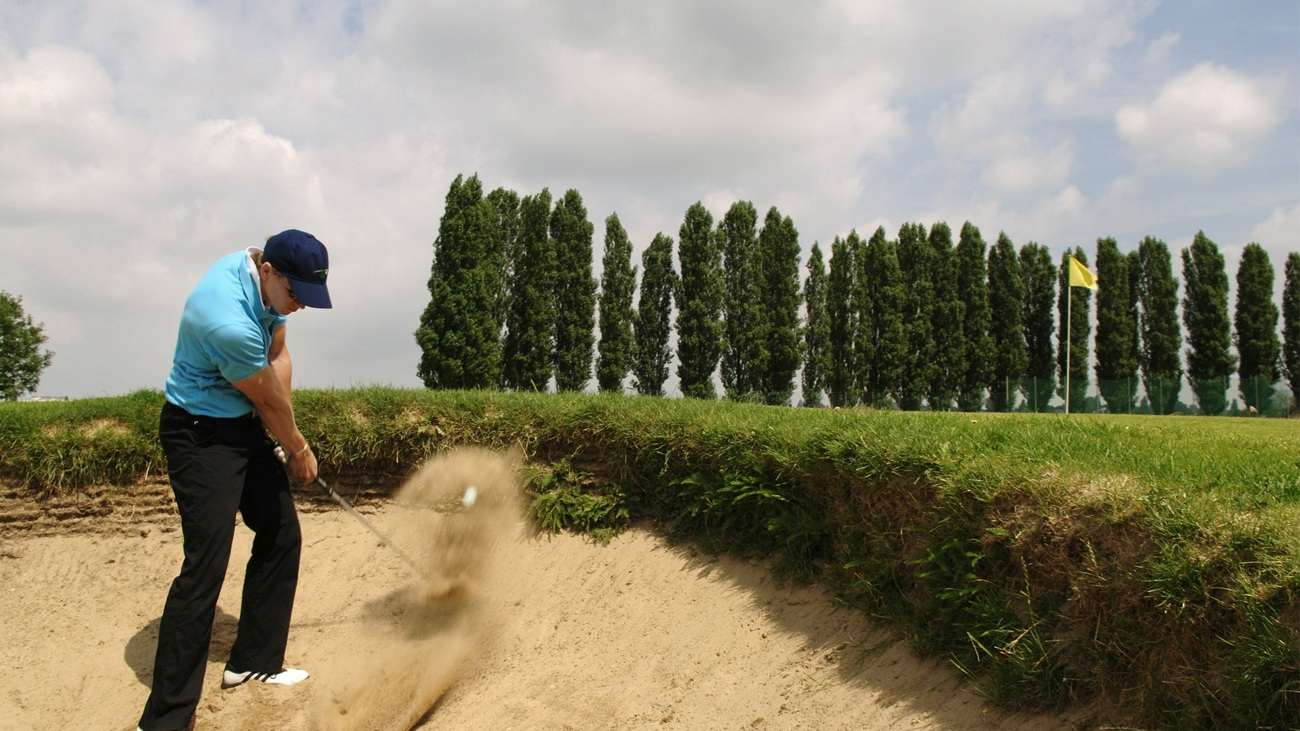 A bunker shot with a sand wedge