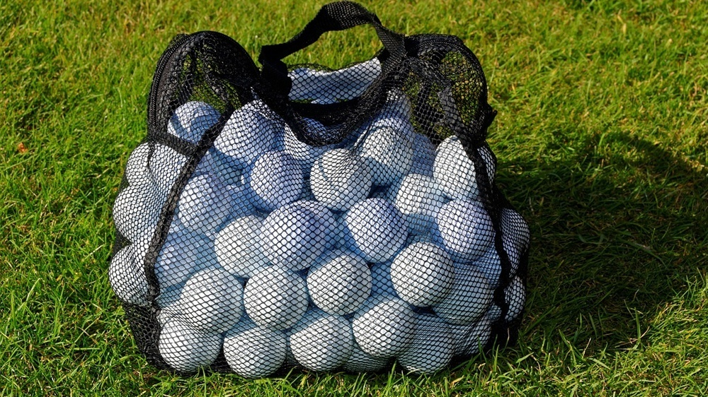 golf ball bag the featured image for how much does a golf ball weigh article.